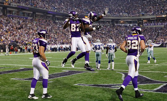 Photograph of Bernard Berrian celebrating after scoring a touchdown against the Dallas Cowboys