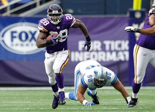Photograph of Adrian Peterson ripping off a long run against the Detroit Lions